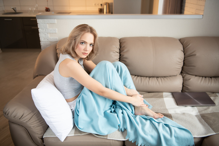 Portrait of a beautiful sexy girl posing on the sofa. Beauty, cosmetics.