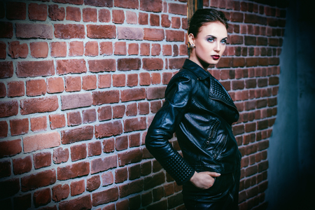 A portrait of a beautiful woman wearing a black leather jacket. Fashion, style. Banque d'images