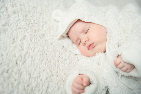 A portrait of a cute sleeping baby. Happiness, parenthood. Goods for newborns.