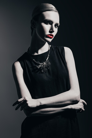 A black and white portrait of a confident lady. Beauty, make-up, style, fashion.