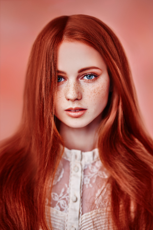 A close up portrait of a lovely mysterious girl with a loose hair. Beauty, cosmetics. Stock Photo
