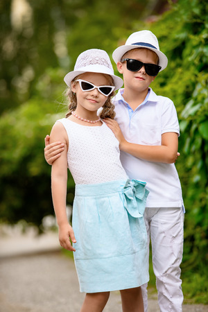 Children are walking in a park. Childhood, summer. Fashion concept. Stock Photo