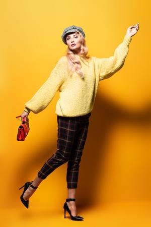 Fashionable bright lady posing in studio. Fashion for women. 写真素材