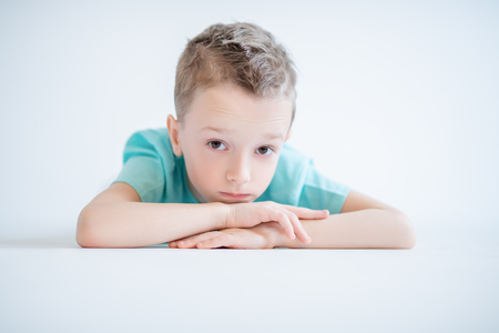 A portrait of a handsome child boy posing in the studio over the white background. Kids, fashion, casual style, beauty.