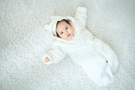 A full length portrait of a cute baby. Happiness, parenthood. Goods for newborns. 写真素材