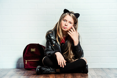 A full length shot of a bright cute schoolgirl. Fashion for active kids. Imagens - 123114097