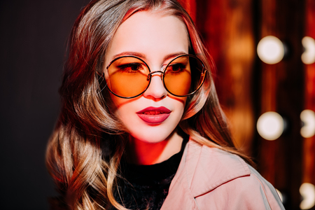 A close up portrait of an elegant lady wearing sunglasses. Beauty, make-up, style.
