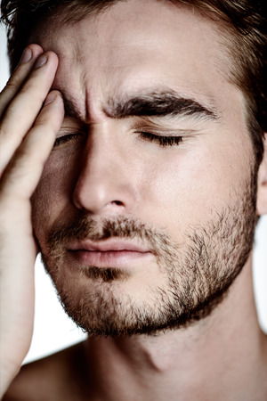 Portrait of a brutal handsome man laid his hand on his face. Male beauty, health. Stock Photo