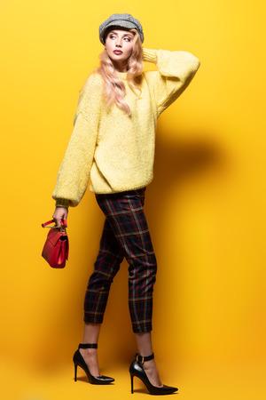 Fashionable bright lady posing in studio. Fashion for women. Stock Photo