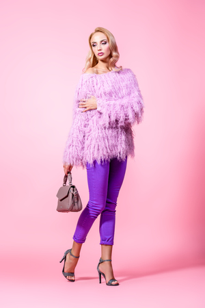 Fashionable bright lady posing in studio. Fashion for women. Pink colors.