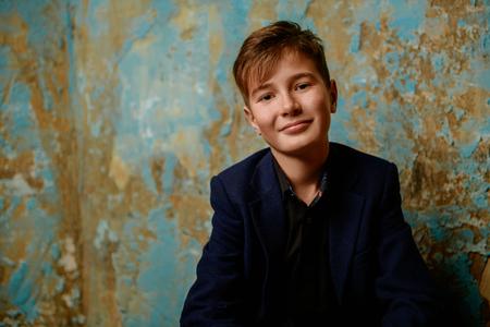 A portrait of a young boy wearing classic shirt. Beauty, fashion, teenagers.