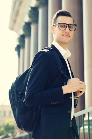 A portrait of a goodlooking young student walking in the street. Mens beauty, fashion. Reklamní fotografie