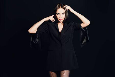 A portrait of a beautiful woman wearing a black blazer. Fashion, style.