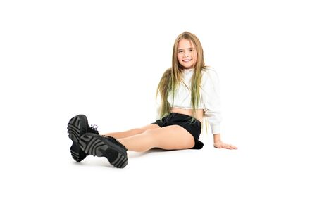 A full length portrait of a young active girl in the studio. Beauty, fashion. Standard-Bild