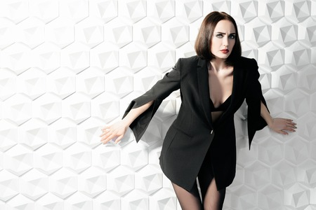 A portrait of a beautiful sexy woman wearing a black blazer. Fashion, style, beauty.