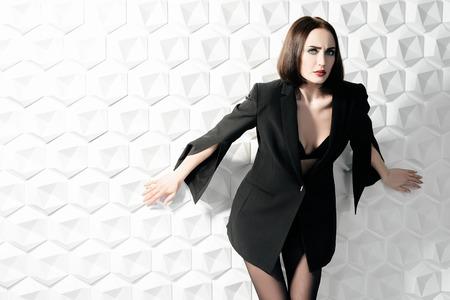 A portrait of a beautiful woman wearing a black blazer. Fashion, style, beauty.