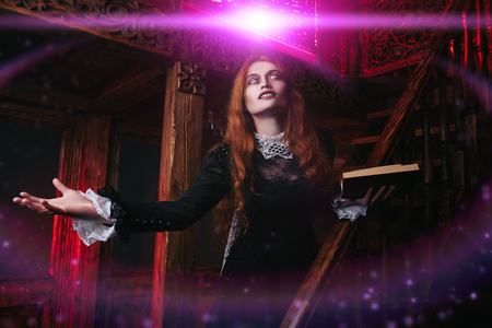 A portrait of an angry witch with a spellbook in her den. Magic, dark force, spell.