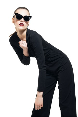 A portrait of a fashionable young lady posing in the studio over the white background. Style, beauty, fashion.