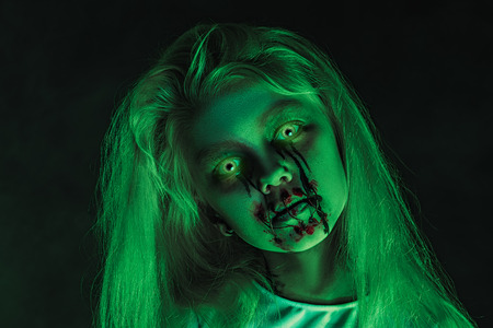 A close up portrait of a scary pale girl from horror film. Zombie, halloween. Фото со стока