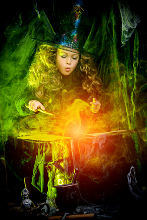 Happy Halloween. Cute little witch casts a spell on a secret book.