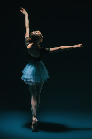 A full length portrait of an elegant refined ballet female dancer posing in the studio over the black background. Talent, fashion for ballet dancers. Stock Photo - 126948838
