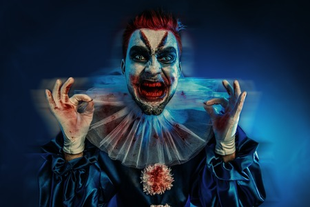 A portrait of an angry crazy clown from a horror film. Halloween, carnival. Stock Photo
