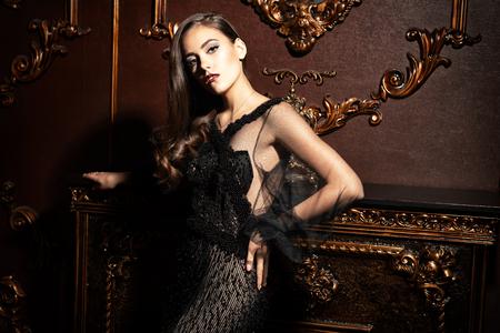 A vampire woman is ready for halloween night. Interior. Celebration.  Beauty. Fashion. Stock Photo