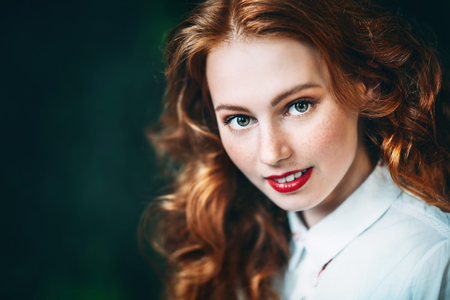 A close up portrait of a gorgeous beautiful young woman posing in the studio. Beauty, cosmetics.