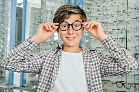 A portrait of a teenage boy. Optics, vision, healthcare. 스톡 콘텐츠