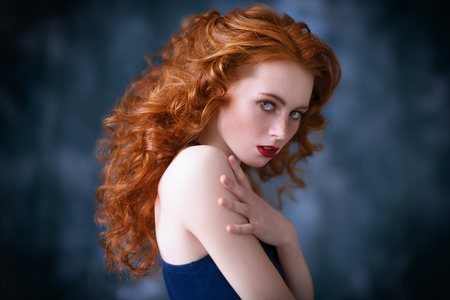 A portrait of a gorgeous beautiful young woman posing in the studio. Beauty, cosmetics.