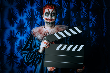 A portrait of a clown man. Actor, horror film. Halloween, carnival.