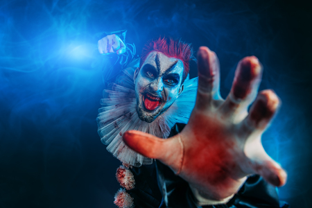 A portrait of an angry crazy clown from a horror film. Halloween, carnival. Standard-Bild