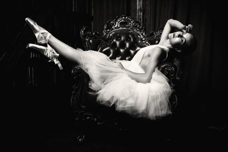 A full length portrait of an elegant refined female ballet dancer posing in the vintage interior. Talent, fashion for ballet dancers. Stock Photo - 128038753