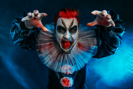 A portrait of an angry crazy clown from a horror film. Halloween, carnival. 스톡 콘텐츠