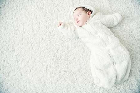 A portrait of a cute sleeping baby. Happiness, parenthood. Goods for newborns. 写真素材 - 128284683