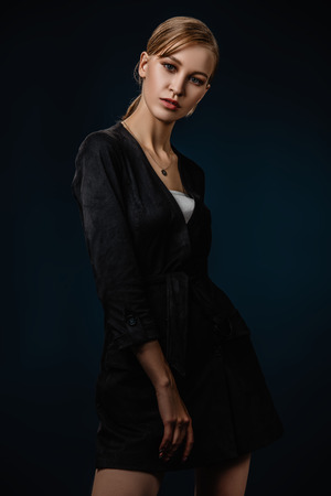 A portrait of a young fashionable woman in a black jumpsuit. Beauty, fashion. Standard-Bild