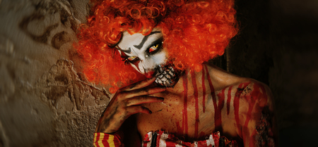 Portrait of a scary clown woman. Halloween, carnival.