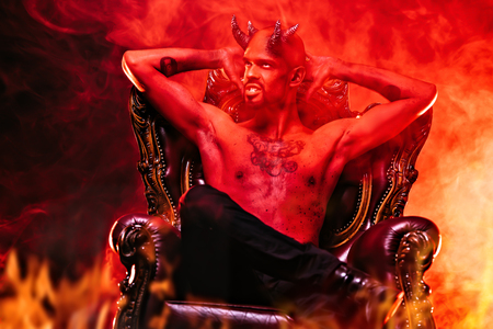 A portrait of a bad demon in his throne. Horror movie, nightmare. Halloween. 스톡 콘텐츠 - 128637772