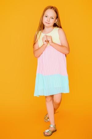 A full length portrait of a young pretty girl. Kids summer casual fashion.
