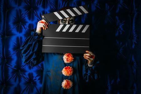 A portrait of a clown man. Actor, horror film. Halloween, carnival. Stock Photo