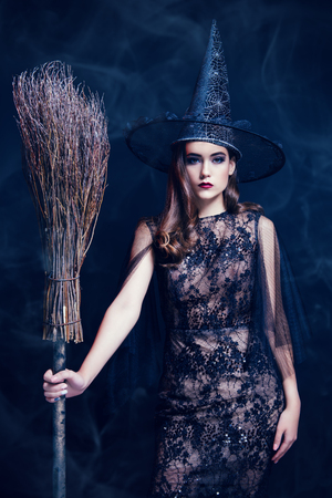 A beautiful lady in a costume of witch. Halloween. Celebration. Stok Fotoğraf - 129014894