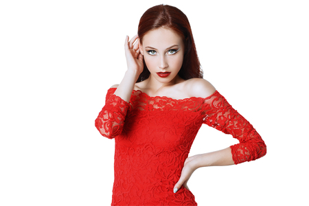 A portrait of a beautiful young woman in a red dress. Beauty, fashion.