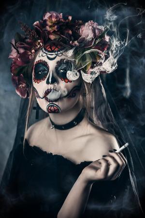 Smoking Calavera Catrina over dark scary background. Sugar skull makeup. Dia de los muertos. Day of The Dead. Halloween.