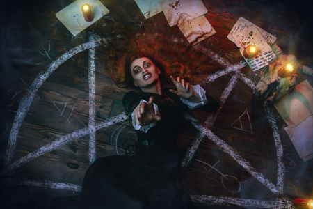 A portrait of a scary witch in the wooden house. Magic, dark force, spell. 写真素材 - 129441850