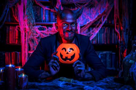 A portrait of a bad demon in his den. Horror movie, nightmare. Halloween.