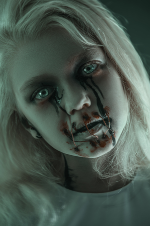A close up portrait of a scary pale girl from horror film. Zombie, halloween. 写真素材 - 129442462