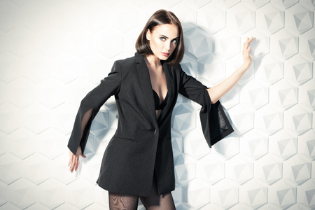 A portrait of a beautiful sexy woman wearing a black blazer. Fashion, style, beauty.