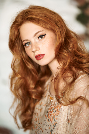 Portrait of a beautiful red-haired girl. Hair coloring. Hippie style. Bohemian style.