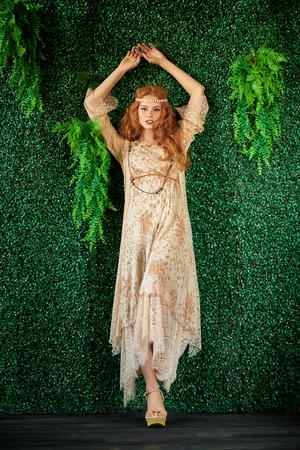 Fashion shot. Beautiful fashion model posing in modern bohemian style. Hippie style.