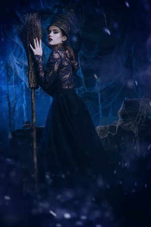 A beautiful lady in a costume of witch. Halloween. Celebration. Stok Fotoğraf - 129600018